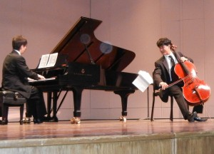 A cellist performs at a KCS recital